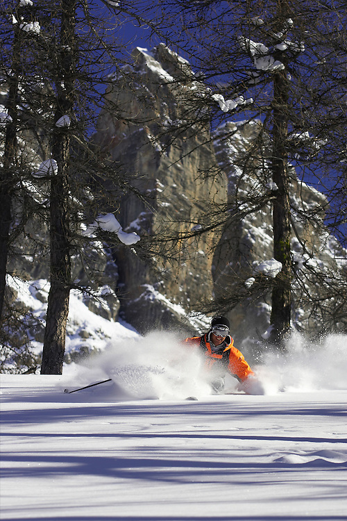 Skier turning in fresh powder snow, Serre Chevalier ski resort, France...Pic. Mike Truelove
