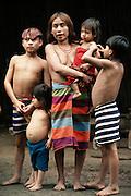 Santo Domingo, Ecuador; Colorado Indian family in front of their home.