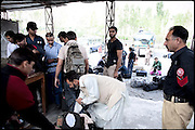 "Antinarcotics border controls, by the local and national police. From the last year some suppliers (pushers) try to multiply incomes through illegal trade between China. Hunza, Pakistan, on thursday, August 21 2008.....""Pakistan is one of the countries hardest hits by the narcotics abuse into the world, during the last years it is facing a dramatic crisis as it regards the heroin consumption. The Unodc (United Nations Office on Drugs and Crime) has reported a conspicuous decline in heroin production in Southeast Asia, while damage to a big expansion in Southwest Asia. Pakistan falls under the Golden Crescent, which is one of the two major illicit opium producing centres in Asia, situated in the mountain area at the borderline between Iran, Afghanistan and Pakistan itself. .During the last 20 years drug trafficking is flourishing in the Country. It is the key transit point for Afghan drugs, including heroin, opium, morphine, and hashish, bound for Western countries, the Arab states of the Persian Gulf and Africa..Hashish and heroin seem to be the preferred drugs prevalence among males in the age bracket of 15-45 years, women comprise only 3%. More then 5% of whole country's population (constituted by around 170 milion individuals),  are regular heroin users, this abuse is conspicuous as more of an urban phenomenon. The substance is usually smoked or the smoke is inhaled, while small number of injection cases have begun to emerge in some few areas..Statistics say, drug addicts have six years of education. Heroin has been identified as the drug predominantly responsible for creating unrest in the society."""