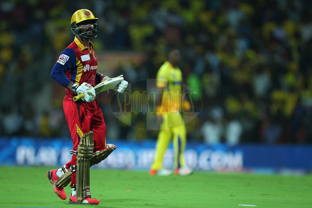 Dinesh Karthik of the Royal Challengers Bangalore departs during match 37 of the Pepsi IPL 2015 (Indian Premier League) between The Chennai Superkings and The Royal Challengers Bangalore held at the M. A. Chidambaram Stadium, Chennai Stadium in Chennai, India on the 4th May April 2015.<br /> <br /> Photo by:  Ron Gaunt / SPORTZPICS / IPL