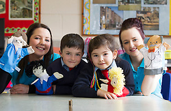 """No fee for Repro: .Junior and Senior Infant pupils at St. Philips National School, Mountview, Dublin 15 had an imagination overload when they welcomed students of ITB's (Institute of Technology Blanchardstown), Early Childhood Care and Education course to their school where they delivered their Story Sack presentations which had the children's imaginations running wild and getting excited about reading. The Story Sack project is part of the Creative Group Facilitation module in conjunction with Fingal County Library, which students cover in their third year of the Early Childhood Care and Education Degree Course. Senior Infant pupils, Jack Nugent and Ella Advic (age 6) are pictured 'Going to the Doctor"""" with the help of ITB students Cloe McFeely from Kinegad and Denise Harney from Trim. Pic Andres Poveda"""
