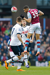 Rudy Gestede of Aston Villa heads the ball as Eric Dier of Tottenham Hotspur looks on - Mandatory byline: Rogan Thomson/JMP - 13/03/2016 - FOOTBALL - Villa Park Stadium - Birmingham, England - Aston Villa v Tottenham Hotspur - Barclays Premier League.