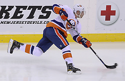 Mar 8; Newark, NJ, USA; New York Islanders defenseman Mark Streit (2) takes a shot during the third period at the Prudential Center. The Devils defeated the Islanders 5-1.