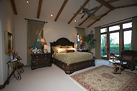 Palm Springs bedroom with beamed ceiling and patio doors