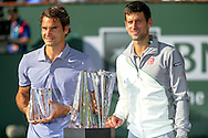 Indian Wells, CA - Roger Federer of Switzerland and Novak Djokovic of Serbia smile during the trophy presentation at the BNP Paribas Open.