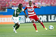 FRISCO, TX - JUNE 26:  Jackson #6 of FC Dallas brings the ball up field defended by Diego Chara #21 of the Portland Timbers on June 26, 2013 at FC Dallas Stadium in Frisco, Texas.  (Photo by Cooper Neill/Getty Images) *** Local Caption *** Jackson; Diego Chara