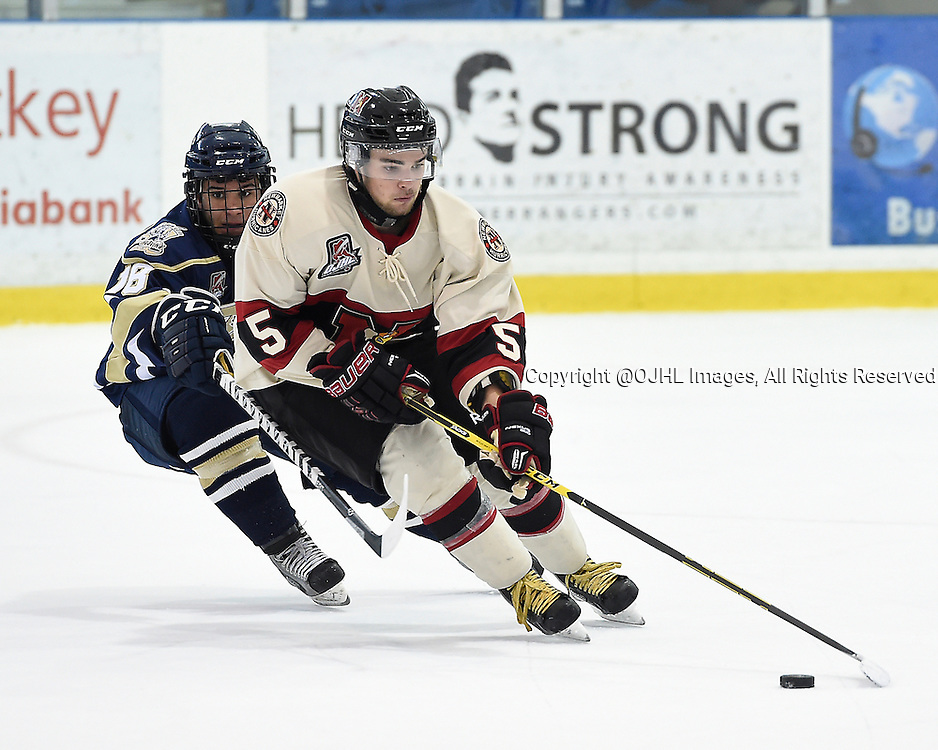OAKVILLE, ON - Sep 28, 2014 : Ontario Junior Hockey League game action between Newmarket and Toronto Lakeshore at the Govenors Showcase Tournament, Chris Maione #18 of the Toronto Patriots Hockey Club tries to keep the puck from Nick Boddy #5 of the Newmarket Hurricanes Hockey Club during the third period.<br /> (Photo by Andy Corneau / OJHL Images)