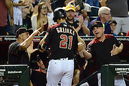 PHOENIX, AZ - MAY 28:  Zack Greinke #21 of the Arizona Diamondbacks is congratulated by Chip Hale #3 after scoring in the second inning against the San Diego Padres at Chase Field on May 28, 2016 in Phoenix, Arizona.  (Photo by Jennifer Stewart/Getty Images)
