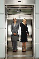 Two Businesswomen in Office Elevator