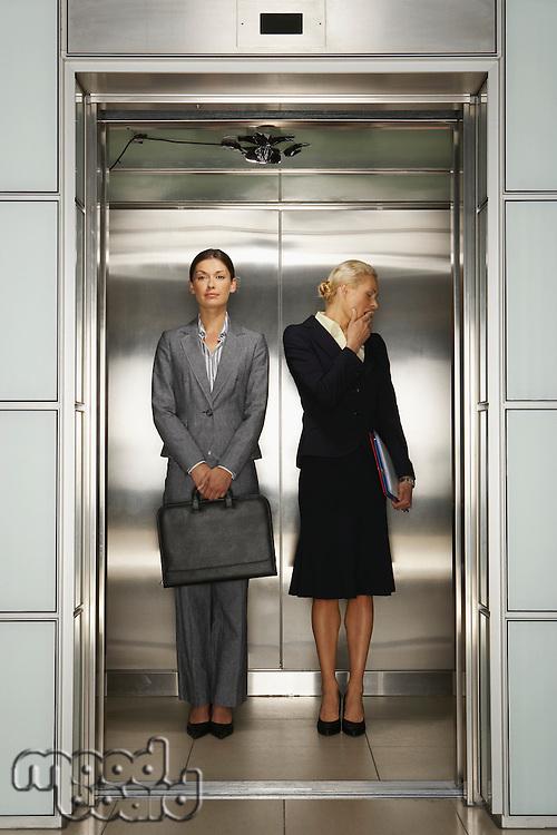 Two Businesswomen in Office Elevator