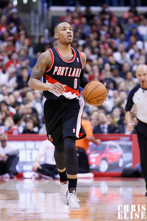 12 February 2014: Portland Trail Blazers point guard Damian Lillard (0) brings the ball up court during the Los Angeles Clippers 122-117 victory over the Portland Trail Blazers at the Staples Center, Los Angeles, California, USA.