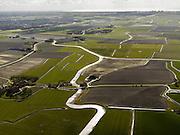 Nederland, Friesland, Gemeente Frankeradeel, 16-04-2012; Kleine Schalsumerpolder in de streek streek De Bouwhoek. Het water van De Ried mondt uit in de Dongjumervaart, bij het gehucht Boer. Dongjum in de achtergrond, links aan de horizon Franeker..Polder landscape with farmground and small river in the north of the Netherlands near the city of Franeker..luchtfoto (toeslag), aerial photo (additional fee required);.copyright foto/photo Siebe Swart