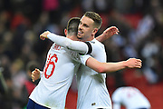 Declan Rice of England hugs Jordan Henderson of England at full time after England won 5-0 during the UEFA European 2020 Qualifier match between England and Czech Republic at Wembley Stadium, London, England on 22 March 2019.