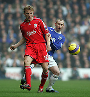 Photo: Paul Thomas.<br /> Liverpool v Everton. The Barclays Premiership. 03/02/2007.<br /> <br /> Dirk Kuyt (L) of Liverpool passes past Tony Hibbert.