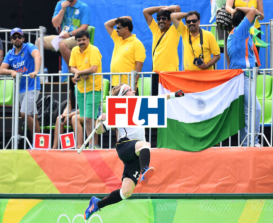 Germany's Christopher Ruhr celebrates scoring a goal during the men's field hockey Germany vs India match of the Rio 2016 Olympics Games at the Olympic Hockey Centre in Rio de Janeiro on August, 8 2016. / AFP / MANAN VATSYAYANA        (Photo credit should read MANAN VATSYAYANA/AFP/Getty Images)