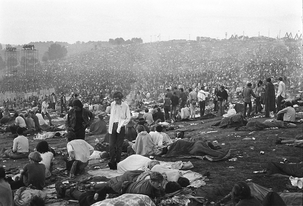 Woodstock Rock Festival fans in the rain wait on the muddy hillside above the stage for the next act to play at the Woodstock rock festival at Max Yasgur's 600 acre farm, in the rural town of Bethel, NY, on the weekend of August 16-18, 1969..