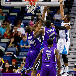December 15, 2010; New Orleans Hornets point guard Chris Paul (3) shoots over Sacramento Kings center Samuel Dalembert (10) during the second half at the New Orleans Arena. The Hornets defeated the Kings 94-91. Mandatory Credit: Derick E. Hingle