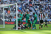 Players from both teams scramble for the ball in the Watord penalty area during the Premier League match between Newcastle United and Watford at St. James's Park, Newcastle, England on 31 August 2019.