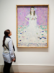 Woman looking at painting Mada Primavesi by Gustav Klimt at Metropolitan Museum of Art in Manhattan , New York City, USA
