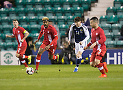 Canada&rsquo;s Manjrekar James strides away from Scotland&rsquo;s Oliver Burke - Scotland v Canada, friendly international at EasterRoad, Edinburgh.Photo: David Young<br /> <br />  - &copy; David Young - www.davidyoungphoto.co.uk - email: davidyoungphoto@gmail.com
