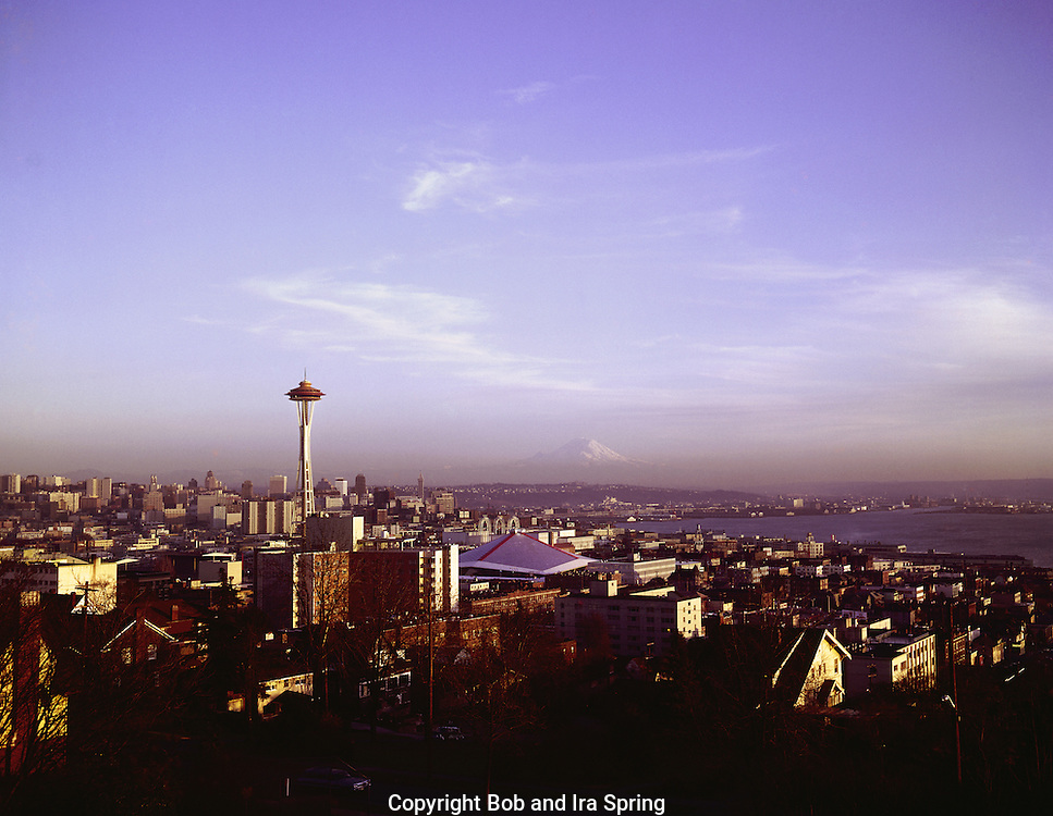 32,819...WASHINGTON - A 1965 photograph of Seattle's skyline and Elliott Bay with Mount Rainier in the distance; taken at sunset from Queen Anne Hill.