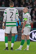 Celtic Captain Scott Brown (C) (#8) talks to his team mate Christopher Jullien (#2) following their 2nd goal during the Europa League match between Celtic and Rennes at Celtic Park, Glasgow, Scotland on 28 November 2019.