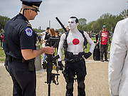 US Capitol Police question Bloodshot (aka Jesse Fresco) and examine his assault rifle and pistols on the Mall, Washington, DC.