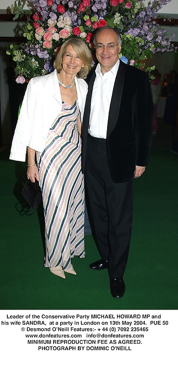 Leader of the Conservative Party MICHAEL HOWARD MP and his wife SANDRA,  at a party in London on 13th May 2004.PUE 50