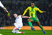 Jack Harrison of Leeds United (22) tackles Rekeem Harper of West Bromwich Albion (34) during the EFL Sky Bet Championship match between Leeds United and West Bromwich Albion at Elland Road, Leeds, England on 1 March 2019.