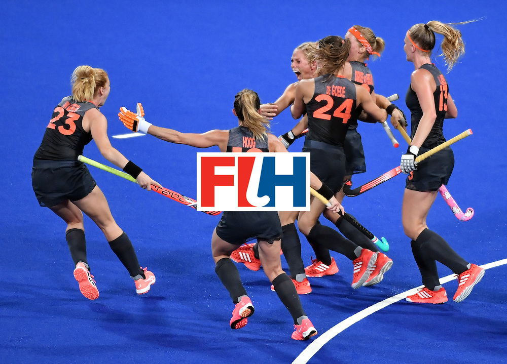 Netherlands' Kitty van Male (3rd L) celebrates after scoring a goal during the women's Gold medal hockey Netherlands vs Britain match of the Rio 2016 Olympics Games at the Olympic Hockey Centre in Rio de Janeiro on August 19, 2016. / AFP / Pascal GUYOT        (Photo credit should read PASCAL GUYOT/AFP/Getty Images)