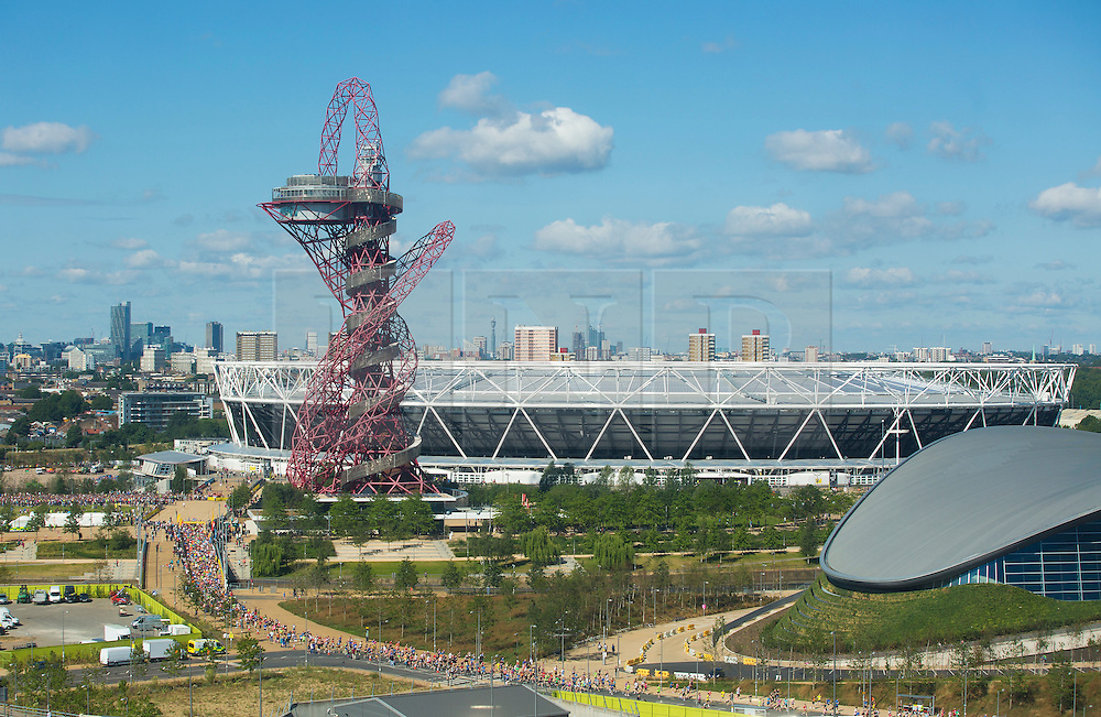 © Licensed to London News Pictures. 19/07/2015. City, UK. A general view of the Queen Elizabeth Olympic Park with the ArcelorMittal Orbit and the Aquatics Centre in sight as the Morrisons Great Newham London Run takes place today around the park. All runners in the 10k ran inside the Olympic Stadium and crossed the famous finish line and running track, which saw Olympic greats Usain Bolt, Jessica Ennis-Hill and Mo Farah race across in 2012. Photo credit : Isabel Infantes / LNP