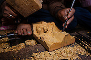 A man carves a deity in soft wood using deft moves and age-old skills learned over decades, while using rudimentary tools in a small village called, Bungamati, just south of Kathmandu, Nepal.
