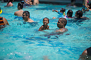 Revelers swim during the Independence Day Pool Party at the Milpitas Sports Center in Milpitas, California, on July 4, 2015. (Stan Olszewski/SOSKIphoto)