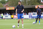 AFC Wimbledon midfielder Anthony Wordsworth (40) and AFC Wimbledon defender Deji Oshilaja (4) warming up during the EFL Sky Bet League 1 match between AFC Wimbledon and Coventry City at the Cherry Red Records Stadium, Kingston, England on 11 August 2018.