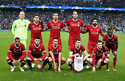 Liverpool Players line up before the match begins. (Back row, left to right) Loris Karius, Roberto Firmino, Roberto Firmino, Virgil van Dijk, Mohamed Salah and Sadio Mane. (Front row, left to right) Georginio Wijnaldum, Alex Oxlade-Chamberlain, Trent Alexander-Arnold, James Milner and Andrew Robertson.