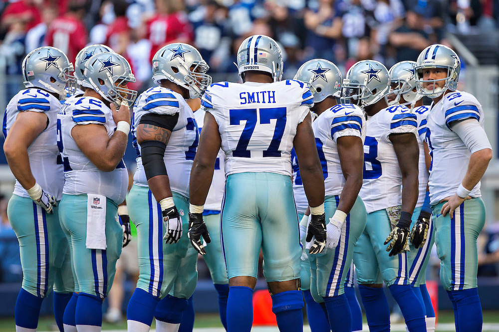 ARLINGTON, TX - NOVEMBER 2:  Tyron Smith #77 of the Dallas Cowboys in the huddle during the second quarter of a game against the Arizona Cardinals at AT&T Stadium on November 2, 2014 in Arlington, Texas.  The Cardinals defeated the Cowboys 28-17.  (Photo by Wesley Hitt/Getty Images) *** Local Caption *** Tyron Smith