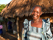 Acham Florence Okorom, 38, is a second wife and she lives on the compound with her co-wife,. They look after 12 children and 3 orphans. Since her training with Send a Cow, Florence has been able to look after the cow and grow enough food to feed all the family with surplus being sold at market. One of the major improvements is being able to give the children breakfast before they go to school.