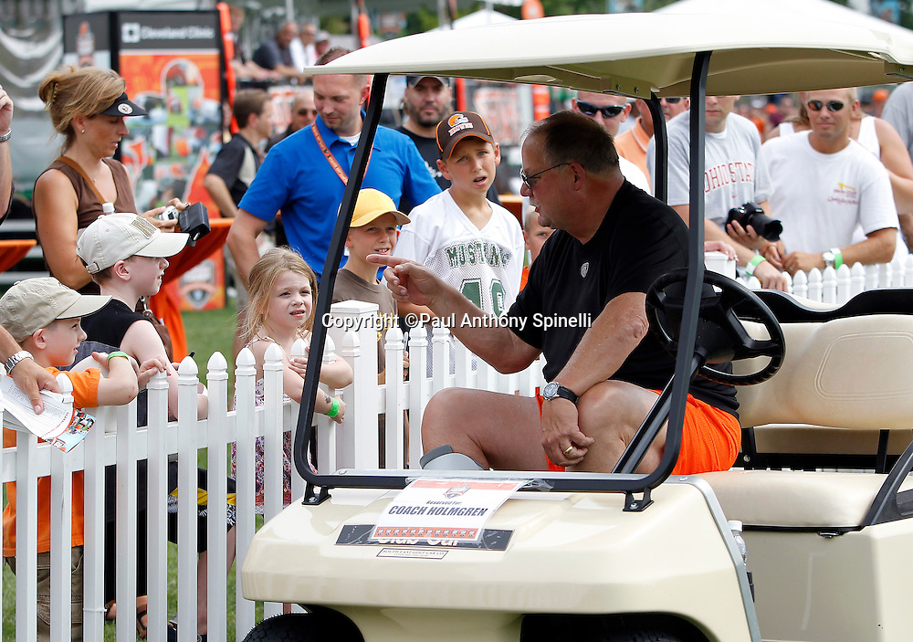 Cleveland Browns team President Mike Holmgren talks to fans during NFL football training camp at the Cleveland Browns Training Complex on Monday, August 9, 2010 in Berea, Ohio. (©Paul Anthony Spinelli)