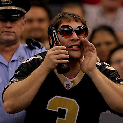 2009 September 13: A NOPD officer observes the actions of a New Orleans Saints fan during a 45-27 win by the New Orleans Saints over the Detroit Lions at the Louisiana Superdome in New Orleans, Louisiana.