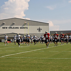August 6, 2011; Metairie, LA, USA; New Orleans Saints quarterback Drew Brees (9) leads his team during training camp practice at the New Orleans Saints practice facility. Mandatory Credit: Derick E. Hingle