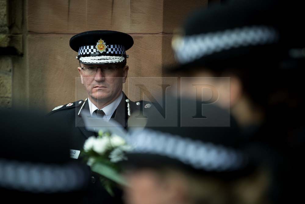 © Licensed to London News Pictures . 15/07/2016 . Bolton , UK . Chief Constable of GMP , IAN HOPKINS , (l) outside the church , ahead of the service . The funeral of Special Constable Samantha Derbyshire at St Mary's RC Church in Horwich , Bolton. Derbyshire was struck and killed by an HGV on the M61 motorway following a collision , in the early hours of Monday 11th July 2016 . Photo credit : Joel Goodman/LNP