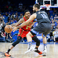 25 February 2017: Atlanta Hawks forward Kent Bazemore (24) passes the ball around Orlando Magic guard Evan Fournier (10) during the Orlando Magic 105-86 victory over the Atlanta Hawks, at the Amway Center, Orlando, Florida, USA.