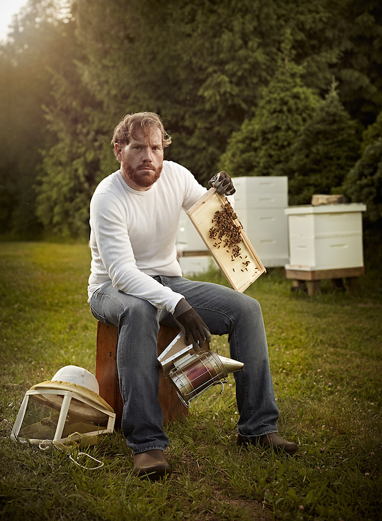Bee Keeper sitting by his bee hives in Ontario Canada shot as a Environmental Portraiture on a PhaseOne IQ180