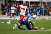 Bristol Rovers midfielder Abu Ogogo is tackled by Jamie Lindsay (16) of Rotherham United during the EFL Sky Bet League 1 match between Bristol Rovers and Rotherham United at the Memorial Stadium, Bristol, England on 28 September 2019.