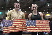 Jan 18, 2019; Reno, NV, USA;Matt Ludwig of Akron (left) and Katie Nageotte pose after finishing as the top American placers during the UCS Spirit National Pole Vault Summit at the Reno-Sparks  Livestock Events Center.