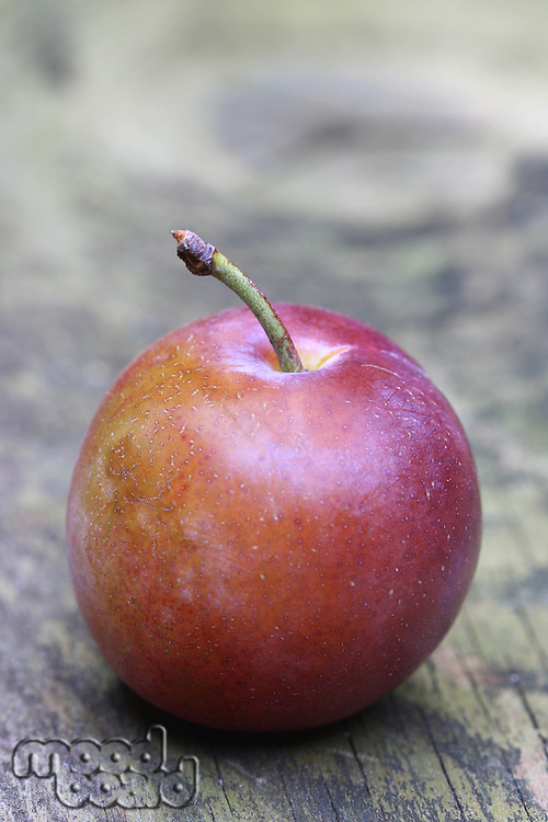 Plums on wooden table - close-up