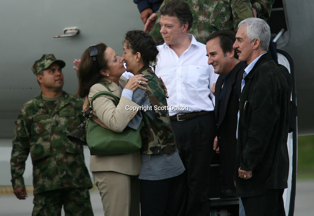 Ingrid Betancourt, who was help captive by FARC rebels for over 6 years, is hugged by her mother upon her arrival to Bogotá after being rescued in a Colombian military operation on July 2, 2008. (Photo/Scott Dalton).