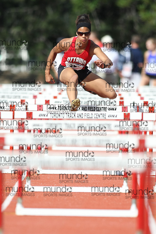 (Toronto, Ontario---3 August 2008)  Claudie Melancon competing in the 100m hurdles at the 2008 OTFA Supermeet II, the Bantam, Midget, Youth Track and Field Championships. This image is copyright Sean W. Burges, and the photographer can be contacted at www.msievents.com.