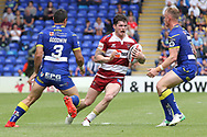 John Bateman of Wigan Warriors attempts to get through the defence of Bryson Goodwin and Kevin Brown of Warrington Wolves during the Ladbrokes Challenge Cup, Quarter Final match at the Halliwell Jones Stadium, Warrington.<br /> Picture by Michael Sedgwick/Focus Images Ltd +44 7900 363072<br /> 02/06/2018