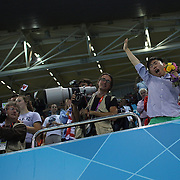 A Chinese fan shows his delight at receiving flowers from Shiwen Ye, China,  after winning the Gold Medal in the Women's  200m Individual Medley Final at the Aquatic Centre at Olympic Park, Stratford during the London 2012 Olympic games. London, UK. 31st July 2012. Photo Tim Clayton